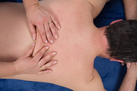 unclothed: Closeup of professional back massage at health center