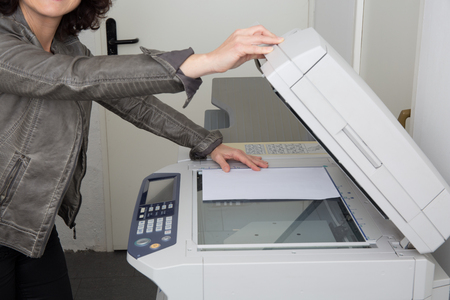 mfp: Womans hands and body with working copier