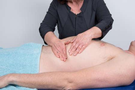 visceral: Man having an abdomen massage at spa center