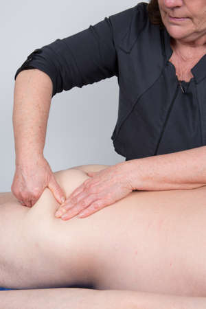 massaged: Laid man being massaged by a woman at spa Stock Photo
