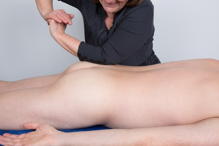 human's elbow: The beautician who massages the back Stock Photo