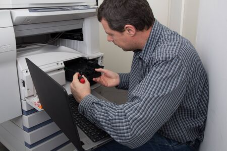 photocopy: Business man opening photocopy machine in office Stock Photo