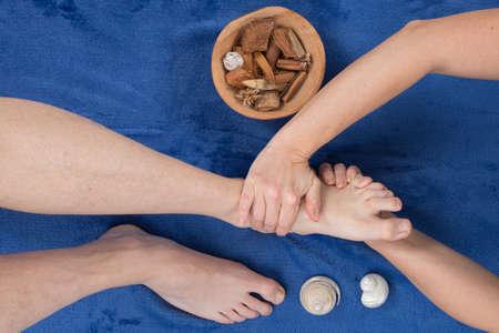 traditional healer: reflexology foot massage, spa foot treatment shiatsu massage Stock Photo