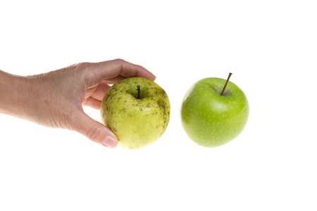 new ages: Womens hands holding an apple