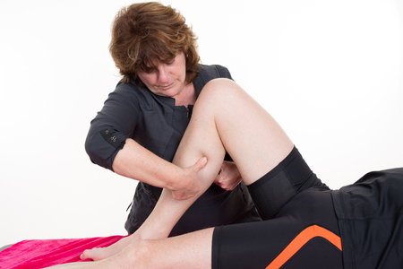 massaged: Massage calf muscle massager oppresses. Masseur massaged  calf.