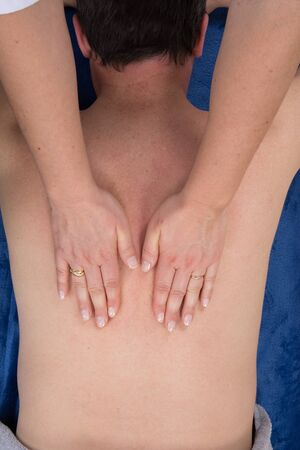 unclothed: Closeup of professional back massage top view Stock Photo