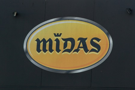 midas: PESSAC, FRANCE - FEBRUARY 10, 2016: Logo of the Midas brand in PESSAC, France. Midas is a company for service and quick repair of American origin .