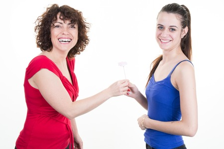 pre adult: Picture of mother and teen girl daughter with flowers