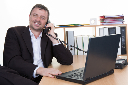 30 to 35: Middle Eastern businessman talking on telephone at office