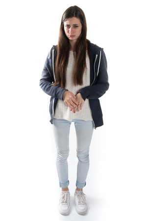 full lenght: Ashamed and afraid young girl full lenght picture isolated Stock Photo