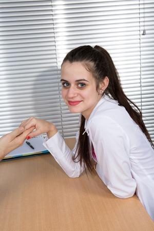 affair: Business Affair. Shot of a girl  flirting in an office