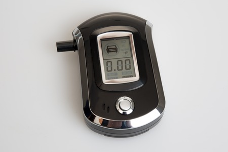 drunkenness: Breathalyzer isolated showing drunkenness, testing alcoholism