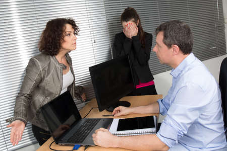 25 30 years women: Three office workers in boardroom, having lively arguments