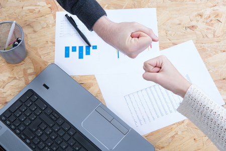actively: Hands of business women are actively discussing the business project. Workplace business woman. Stock Photo