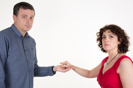 splitting up: break up . Woman is taking off the ring from hand and give to her husband