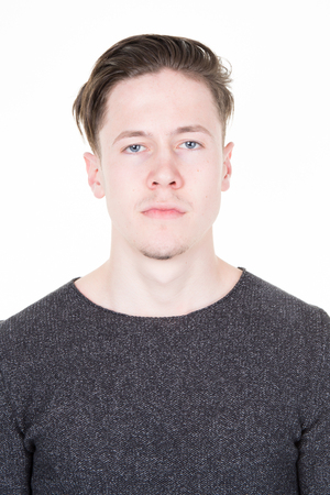 Passport picture of a cool guy in a grey shirt isolated