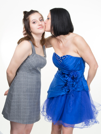beauties: Glamorous portrait of two beauties. Mother kissing her pretty daughter