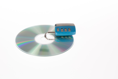 ou: Data security, cd ou dvd with a key lock means security of your data Stock Photo
