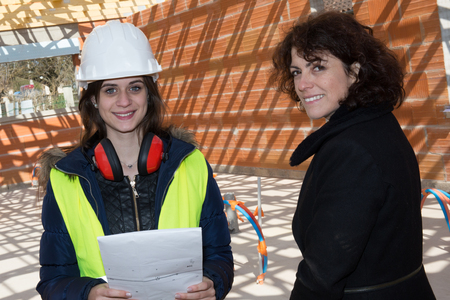female architect: Female architect and female customer visiting site Stock Photo