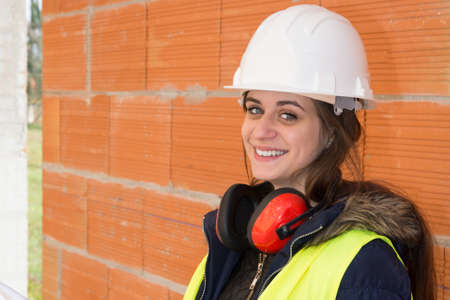 female architect: Female architect at a construction site looking happy and smiling