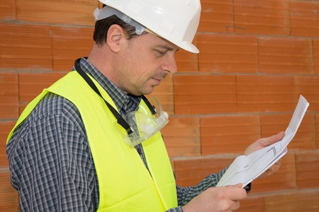 blue print: Builder worker with blue print at construction site