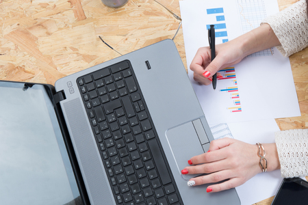 data sheet: Concept of woman business analysis - data sheet, and laptop