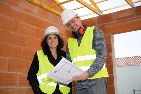 security helmet: Closeup of construction people with white security helmet Stock Photo