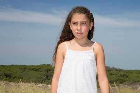 Pretty sunny portrait of a young girl. Long hair girl on beach