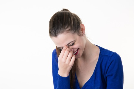 horrify: Woman giggles covering her mouth with hand isolated