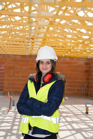 workwoman: Young woman architect on the building site of the construction project Stock Photo