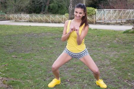 Woman doing a kick boxing workout outside