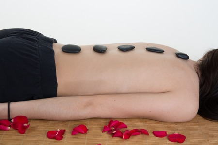 hot stones: picture of woman in spa salon with hot stones