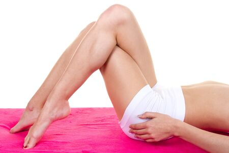 shoeless: Legs, hands and body of the woman on a white background