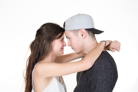 each: Beautiful young couple looking at each other Stock Photo