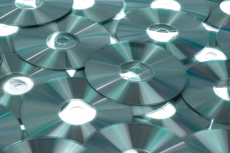 device disc: CD background, black and white, slightly toned Stock Photo