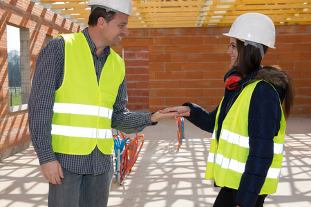 agree: Construction Engineers holding hands to be agree