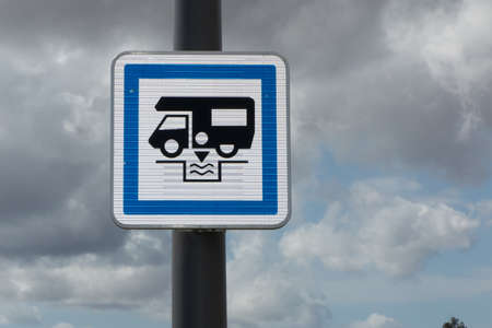dumping: Camper sign in Europe, blue sign on a pole for dumping station