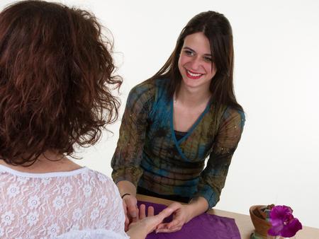 diviner: Female fortune teller is reading the lifeline and heart line, concept palmistry