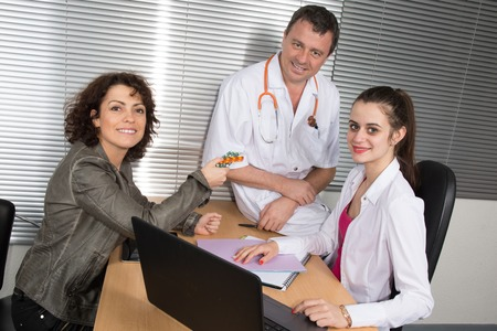 sales rep: Woman Pharmaceutical Sales Representative with two doctors