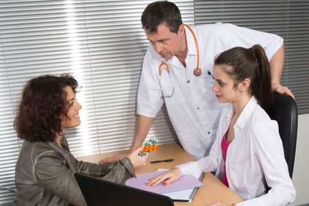 sales rep: Happy medical rep in a meeting with doctors