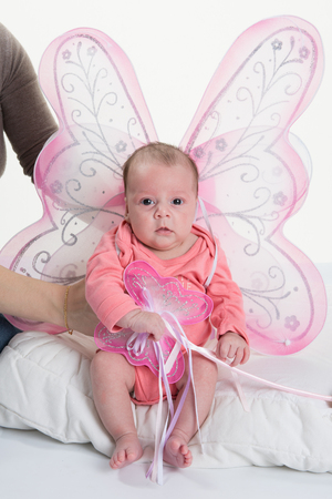 2 5 months: 2 months old baby girl held on mothers arms with wings fairy