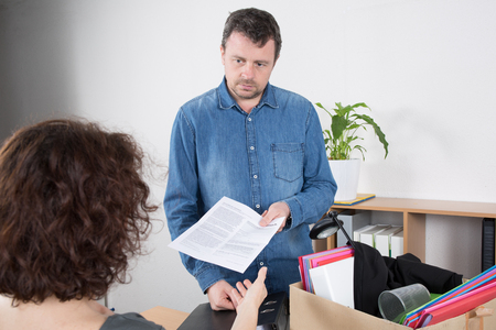dismiss: Man given a dismiss notification by his female boss at office