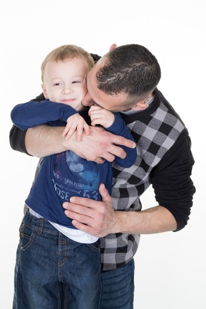 role models: Father kissing his son, three years old Stock Photo