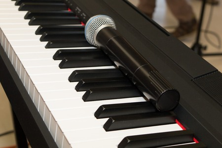 closedup: Microphone on piano keyboard background,closed-up