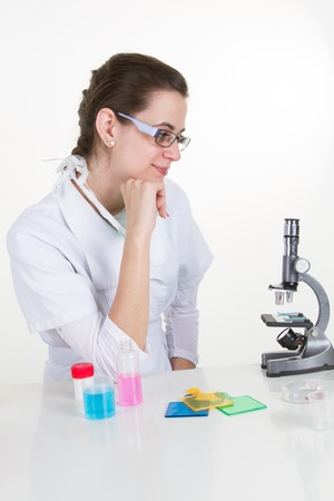 intent: Female researcher thinking at her workplace in a laboratory. Stock Photo