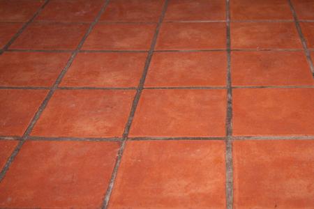 Abstracte bruine bakstenen tegelsvloer - de achtergrond van de tegelstextuur