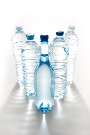 reflection of life: plastic bottles of water isolated on white Stock Photo