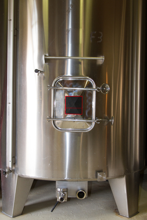 fermentation: Stainless steel fermentation tanks vessels indoor of a french winery Stock Photo