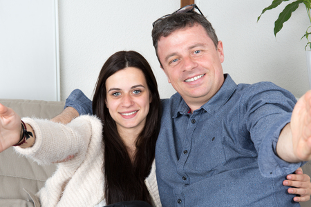 single father: Family selfie single father with his daughter, on the couch at home