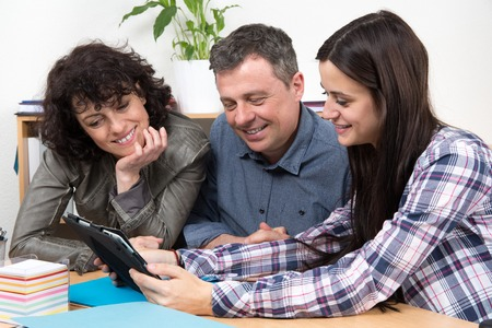 advisers: Successful team of  business people looking at tablet computer for a presentation.